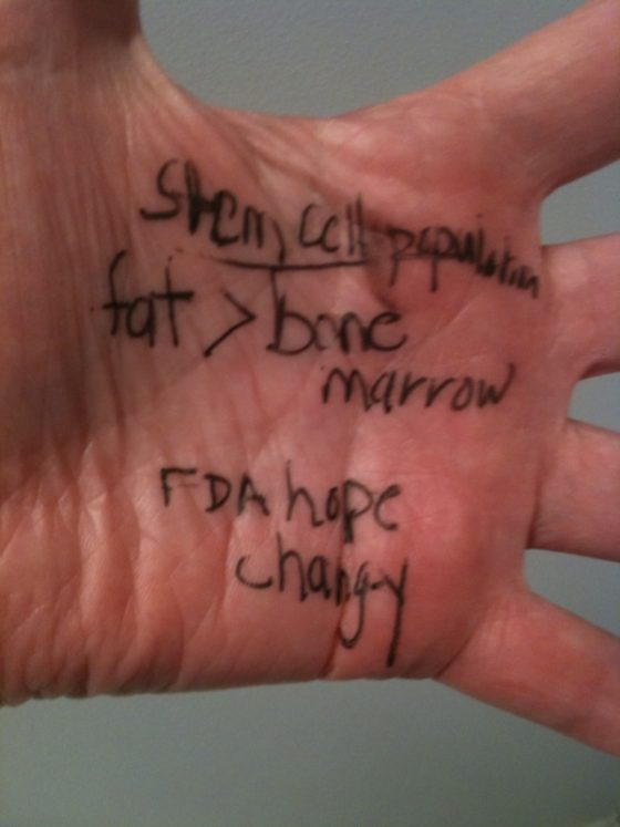 A photo of the inside of a hand with notes about stem cells.