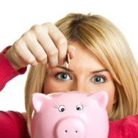 A woman saving money in piggy bank.