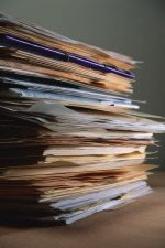 A stack of incomplete case files.