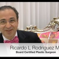 Dr. Ricardo L. Rodriguez sitting in a chair.