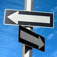 2 road signs pointing in different directions.